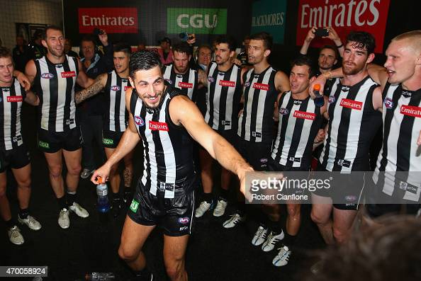 Patrick Karnezis of the Magpies celebrates with team mates after the Magpies defeated the Sainst in the round three AFL match between the Collingwood...