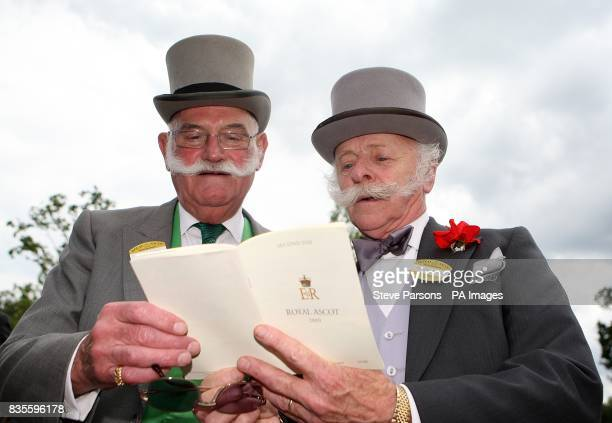 Patrick Keogh and Dennis Nuttledge observe the days racing card at Ascot Racecourse Berkshire