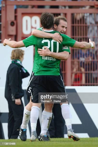 Patrick Kirsch and Wojciech Pollok of Muenster celebrate their team's first goal during the Regionalliga West match between Preussen Muenster and...