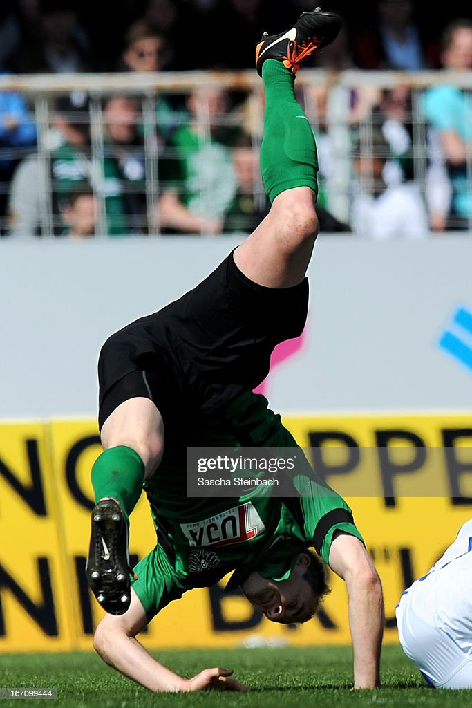 Patrick Kirsch of Muenster is brought down during the 3. Liga match between Preussen Muenster and Karlsruher SC at Preussenstadion on April 20, 2013 in Muenster, Germany.