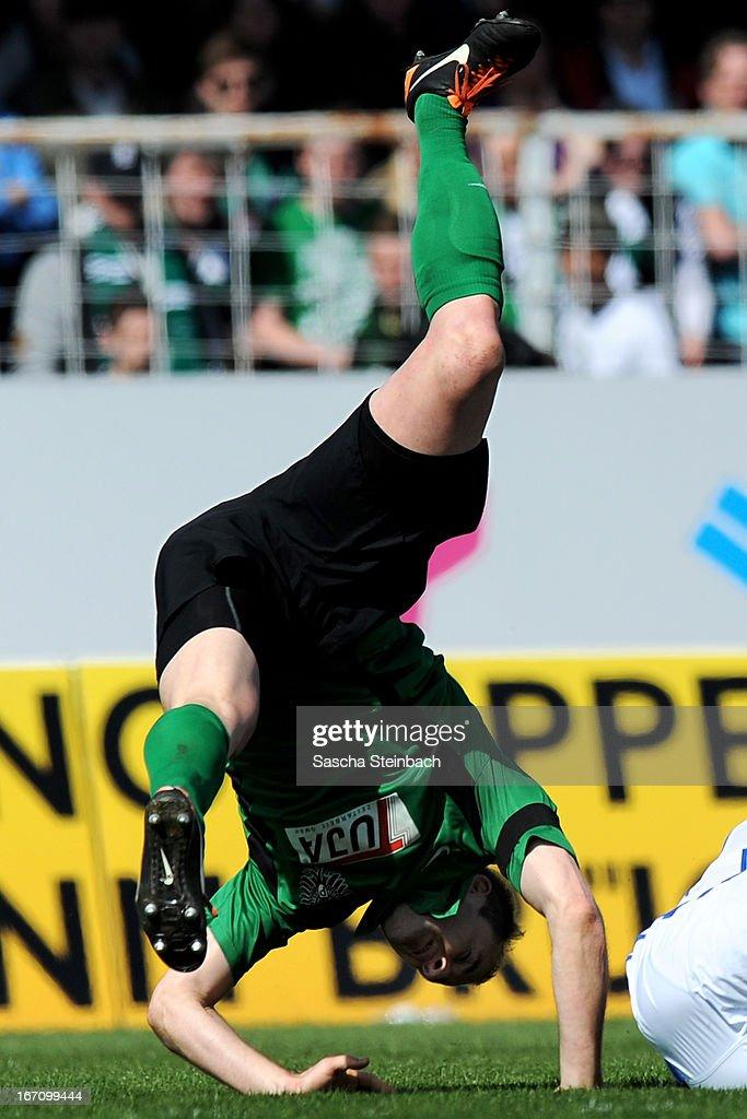 Patrick Kirsch of Muenster is brought down during the 3. Liga match between Preussen Muenster and Karlsruher SC at Preussenstadion on April 20, 2013 in Muenster, Germany.