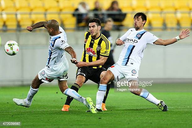 Patrick Kisnorbo and Jonatan Germano of Melbourne City defend against Michael Boxall of the Phoenix during the ALeague Elimination match between the...