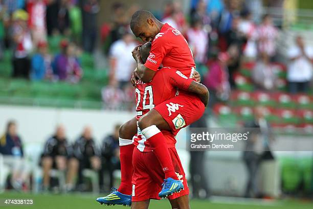 Patrick Kisnorbo and Patrick Gerhardt of the Heart embrace following victory in the round 20 ALeague match between Melbourne Heart and Brisbane Roar...