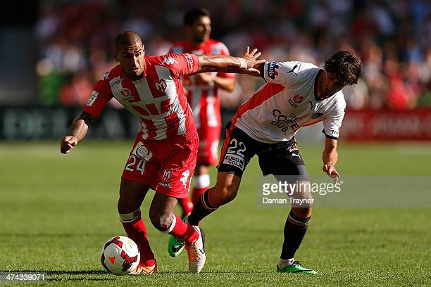Patrick Kisnorbo of Melbourne and Thomas Broich of Brisbane compete during the round 20 ALeague match between Melbourne Heart and Brisbane Roar at...