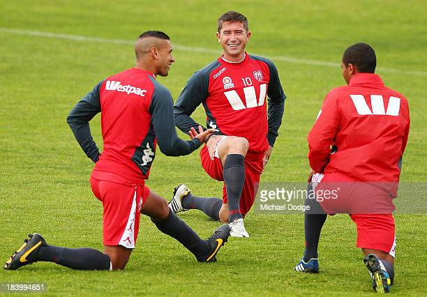 Patrick Kisnorbo talks with Harry Kewell and Patrick Gerhardt during a Melbourne Heart ALeague training session at Epping Stadium on October 11 2013...