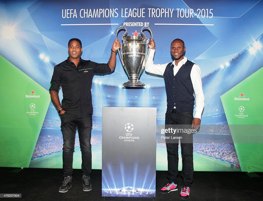 <a gi-track='captionPersonalityLinkClicked' href=/galleries/search?phrase=Patrick+Kluivert&family=editorial&specificpeople=167278 ng-click='$event.stopPropagation()'>Patrick Kluivert</a> and Eric Abidal hold the trophy at the UEFA Champions League Trophy Tour presented by Heineken - Dallas Stop at Clive Warren Park April 17, 2015 in Dallas, Texas.