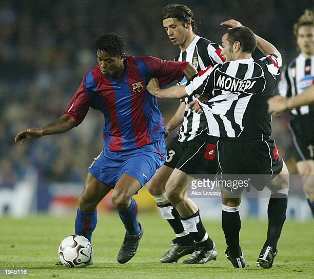 Patrick Kluivert of Barcelona beats Paolo Montero of Juventus during the UEFA Champions League QuarterFinal second leg match between Barcelona and...