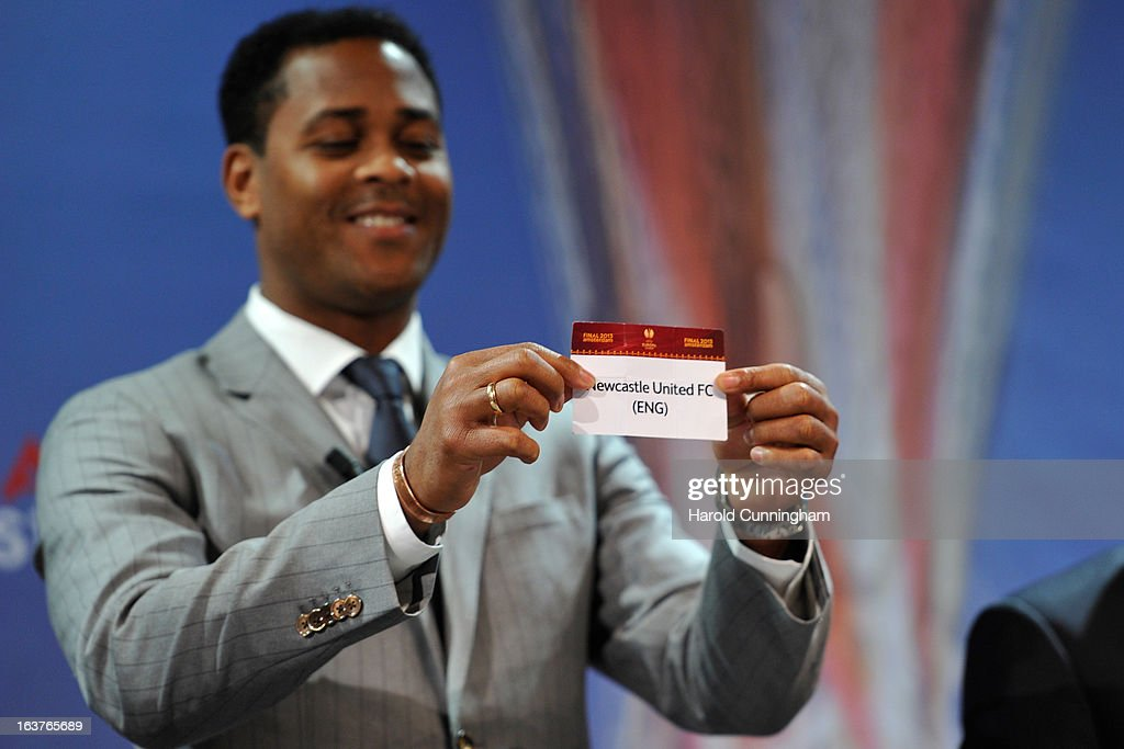 Patrick Kluivert, UEFA Europa League Final Ambassador, shows the name Newcastle United FC during the UEFA Europa League quarter finals draw at the UEFA headquarters on March 15, 2013 in Nyon, Switzerland.