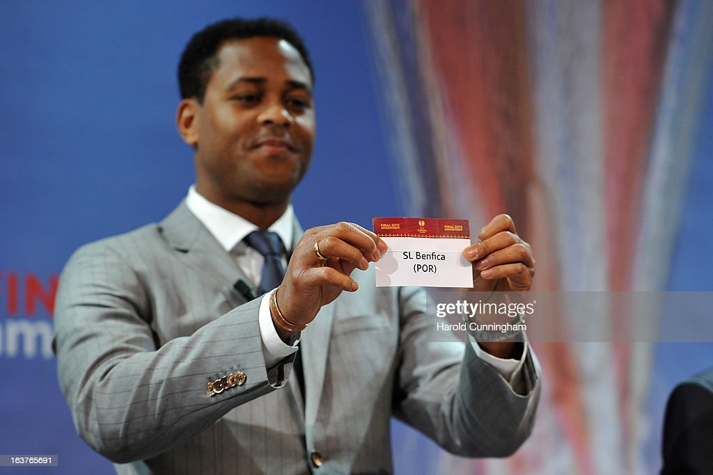 Patrick Kluivert, UEFA Europa League Final Ambassador, shows the name SL Benfica during the UEFA Europa League quarter finals draw at the UEFA headquarters on March 15, 2013 in Nyon, Switzerland.