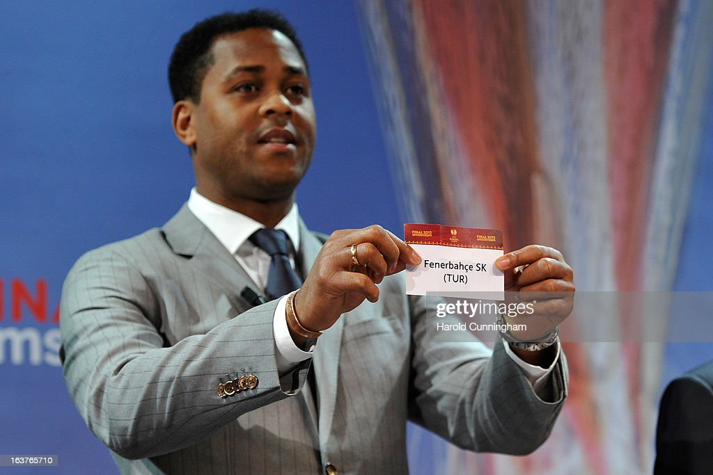 Patrick Kluivert, UEFA Europa League Final Ambassador, shows the name Fenerbahce SK during the UEFA Europa League quarter finals draw at the UEFA headquarters on March 15, 2013 in Nyon, Switzerland.
