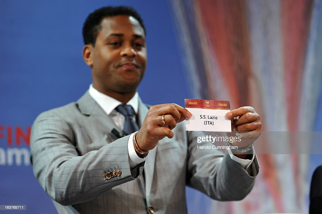 Patrick Kluivert, UEFA Europa League Final Ambassador, shows the name S.S. Lazio during the UEFA Europa League quarter finals draw at the UEFA headquarters on March 15, 2013 in Nyon, Switzerland.