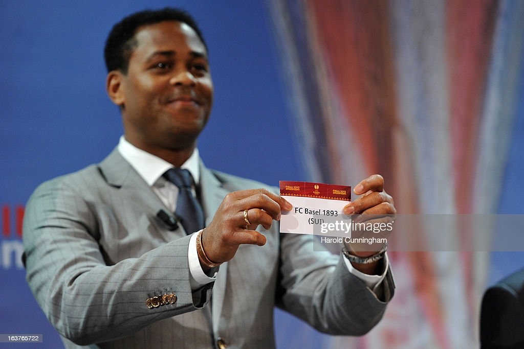 Patrick Kluivert, UEFA Europa League Final Ambassador, shows the name FC Basel 1893 during the UEFA Europa League quarter finals draw at the UEFA headquarters on March 15, 2013 in Nyon, Switzerland.
