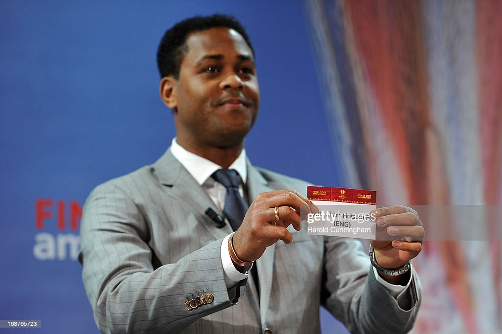 Patrick Kluivert, UEFA Europa League Final Ambassador, shows the name Tottenham Hotspur FC during the UEFA Europa League quarter finals draw at the UEFA headquarters on March 15, 2013 in Nyon, Switzerland.