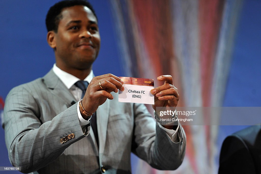 Patrick Kluivert, UEFA Europa League Final Ambassador, shows the name Chelsea FC during the UEFA Europa League quarter finals draw at the UEFA headquarters on March 15, 2013 in Nyon, Switzerland.