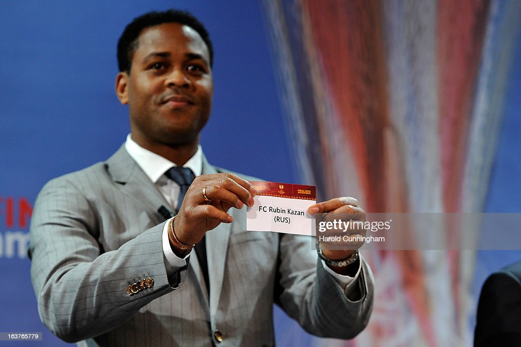 Patrick Kluivert, UEFA Europa League Final Ambassador, shows the name Rubin Kazan during the UEFA Europa League quarter finals draw at the UEFA headquarters on March 15, 2013 in Nyon, Switzerland.