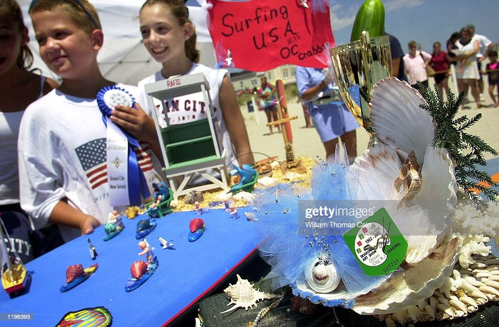 Patrick Knause 10yearsold of Swarthmore Pennsylvania stands after placing his hermit crab on a throne after the crab won first place in the 27th...