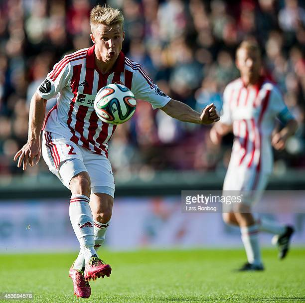 Patrick Kristensen of AaB Aalborg controls the ball during the Danish Superliga match between AaB Aalborg and Esbjerg FB at Nordjyske Arena on August...