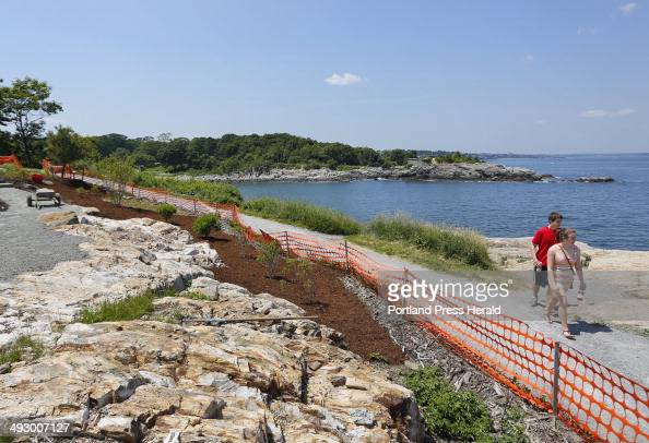 Patrick LaChance and Sarah Small both of Raymond walk along a trail as work continues at the arboretum at Fort Williams Park Photographed on...