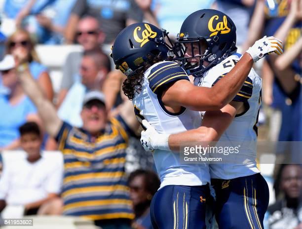 Patrick Laird celebrates with teamate Kanawai Noa of the California Golden Bears after scoring on a 54yard pass against the North Carolina Tar Heels...