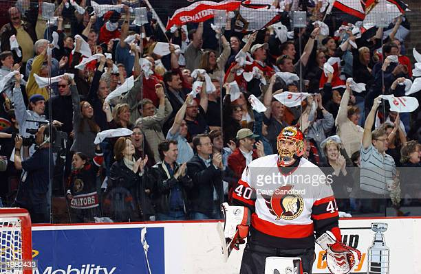 Patrick Lalime of the Ottawa Senators skates to the net as fans cheer during game five of the Stanley Cup Eastern Conference SemiFinals against the...