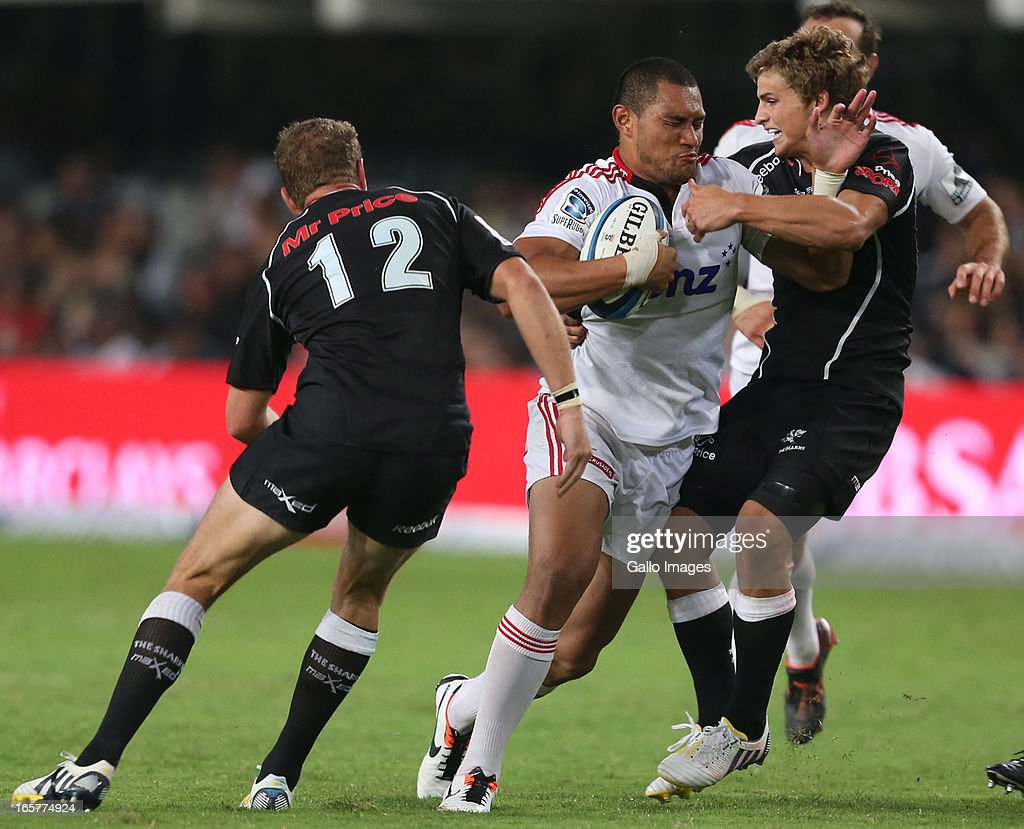 Patrick Lambie of Sharks tries to hold onto Robbie Fruean of Crusaders during the Super Rugby match between The Sharks and Crusaders from Kings Park on April 05, 2013 in Durban, South Africa.