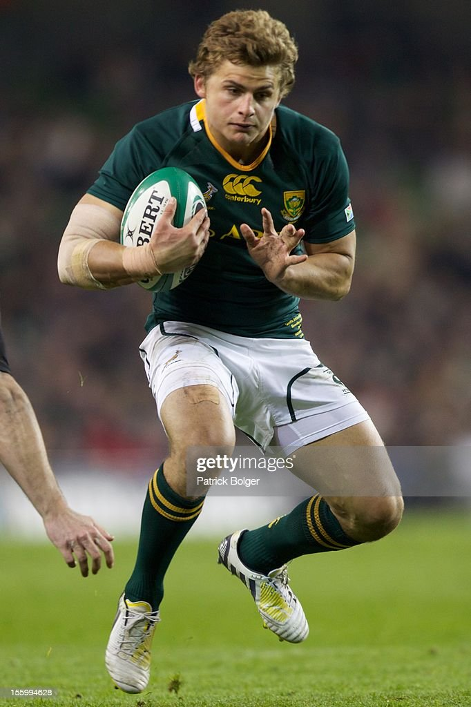<a gi-track='captionPersonalityLinkClicked' href=/galleries/search?phrase=Patrick+Lambie&family=editorial&specificpeople=6849711 ng-click='$event.stopPropagation()'>Patrick Lambie</a> of South Africa competes during the International rugby match between Ireland and South Africa in the Aviva Stadium on November 10, 2012 in Dublin, Ireland.