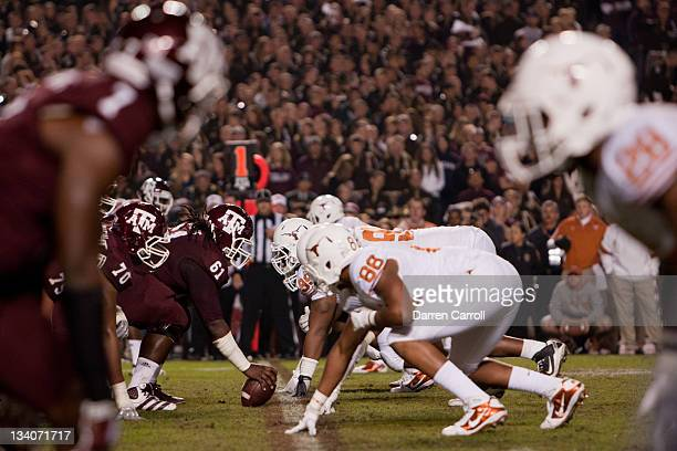 Patrick Lewis of the Texas AM Aggies prepares to snap the ball against the Texas Longhorns in the second half of a game at Kyle Field on November 24...