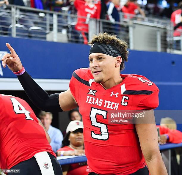 Patrick Mahomes II of the Texas Tech Red Raiders interacts with fans after the game against the Baylor Bears on November 25 2016 at ATT Stadium in...