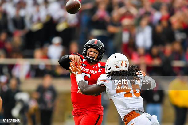 Patrick Mahomes II of the Texas Tech Red Raiders passes the ball while under pressure from Malik Jefferson of the Texas Longhorns during the first...