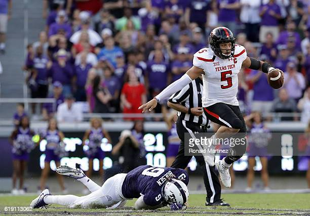 Patrick Mahomes II of the Texas Tech Red Raiders runs for a first down on fourth against Mat Boesen of the TCU Horned Frogs in the second half at...