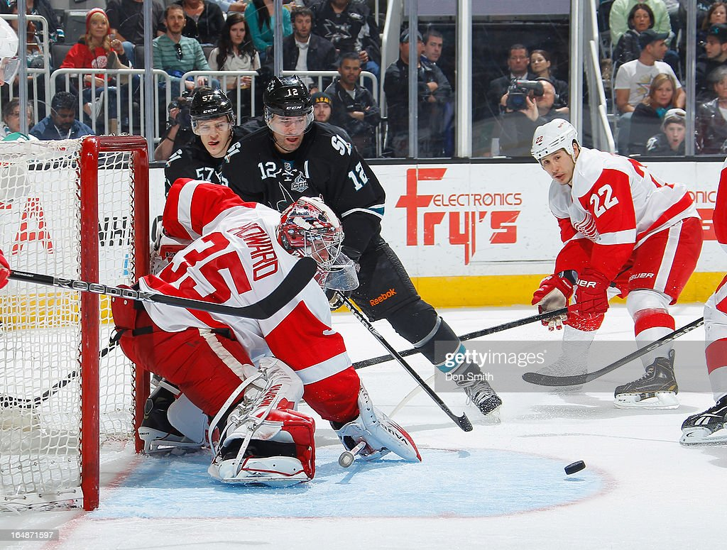 <a gi-track='captionPersonalityLinkClicked' href=/galleries/search?phrase=Patrick+Marleau&family=editorial&specificpeople=203165 ng-click='$event.stopPropagation()'>Patrick Marleau</a> #12 and <a gi-track='captionPersonalityLinkClicked' href=/galleries/search?phrase=Tommy+Wingels&family=editorial&specificpeople=5807738 ng-click='$event.stopPropagation()'>Tommy Wingels</a> #57 of the San Jose Sharks try to score against Jimmy Howard #35 and <a gi-track='captionPersonalityLinkClicked' href=/galleries/search?phrase=Jordin+Tootoo&family=editorial&specificpeople=203013 ng-click='$event.stopPropagation()'>Jordin Tootoo</a> #22 of the Detroit Red Wings during an NHL game on March 28, 2013 at HP Pavilion in San Jose, California.