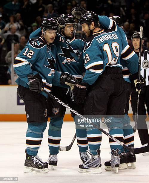 Patrick Marleau Dany Heatley Douglas Murray and Joe Thornton of the San Jose Sharks celebrate scoring a goal during their game against the Edmonton...
