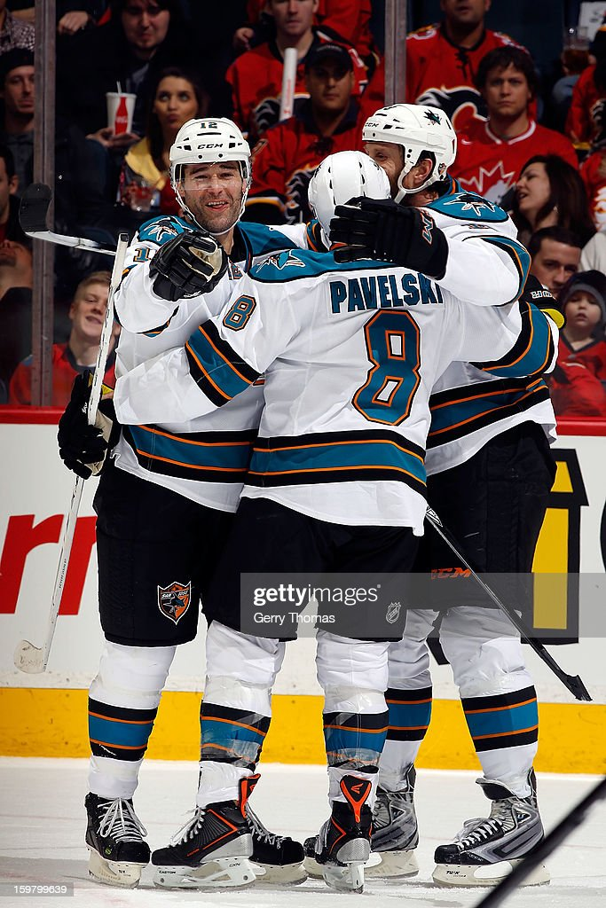 <a gi-track='captionPersonalityLinkClicked' href=/galleries/search?phrase=Patrick+Marleau&family=editorial&specificpeople=203165 ng-click='$event.stopPropagation()'>Patrick Marleau</a> #12, <a gi-track='captionPersonalityLinkClicked' href=/galleries/search?phrase=Joe+Pavelski&family=editorial&specificpeople=687042 ng-click='$event.stopPropagation()'>Joe Pavelski</a> #8 and <a gi-track='captionPersonalityLinkClicked' href=/galleries/search?phrase=Joe+Thornton&family=editorial&specificpeople=201829 ng-click='$event.stopPropagation()'>Joe Thornton</a> #19 of the San Jose Sharks celebrate a goal against the Calgary Flames on January 20, 2013 at the Scotiabank Saddledome in Calgary, Alberta, Canada.