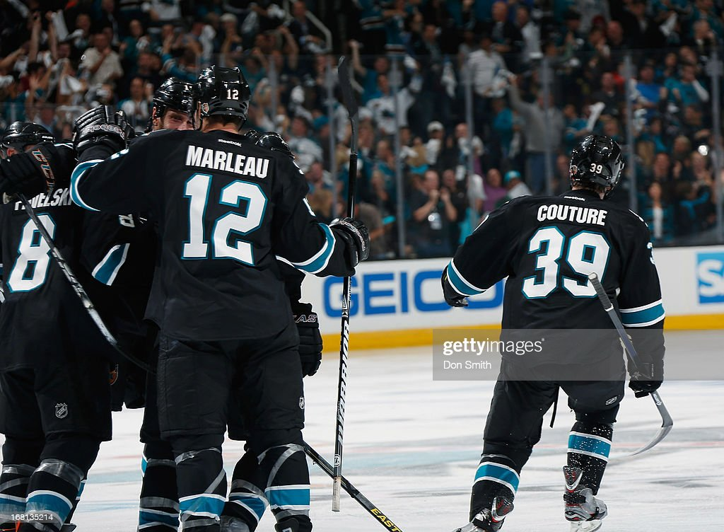 Patrick Marleau #12, Joe Pavelski #8 and Logan Couture #39 of the San Jose Sharks celebrate a goal against the Vancouver Canucks in Game One of the Western Conference Quarterfinals during the 2013 Stanley Cup Playoffs at HP Pavilion on May 5, 2013 in San Jose, California.