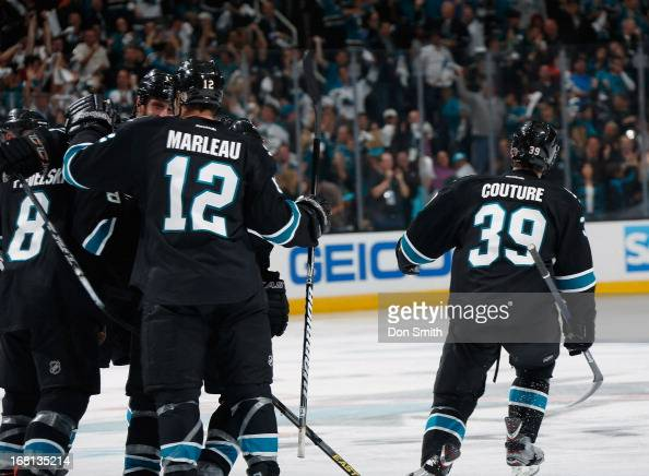 Patrick Marleau Joe Pavelski and Logan Couture of the San Jose Sharks celebrate a goal against the Vancouver Canucks in Game One of the Western...
