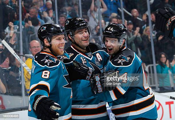 Patrick Marleau Joe Pavelski and MarcEdouard Vlasic of the San Jose Sharks celebrate a goal against the Phoenix Coyotes during an NHL game on January...