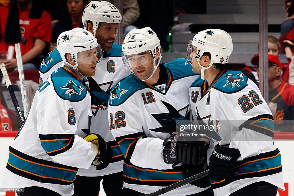 <a gi-track='captionPersonalityLinkClicked' href=/galleries/search?phrase=Patrick+Marleau&family=editorial&specificpeople=203165 ng-click='$event.stopPropagation()'>Patrick Marleau</a> #12, <a gi-track='captionPersonalityLinkClicked' href=/galleries/search?phrase=Joe+Pavelski&family=editorial&specificpeople=687042 ng-click='$event.stopPropagation()'>Joe Pavelski</a> #8, <a gi-track='captionPersonalityLinkClicked' href=/galleries/search?phrase=Dan+Boyle&family=editorial&specificpeople=201502 ng-click='$event.stopPropagation()'>Dan Boyle</a> #22 and <a gi-track='captionPersonalityLinkClicked' href=/galleries/search?phrase=Joe+Thornton&family=editorial&specificpeople=201829 ng-click='$event.stopPropagation()'>Joe Thornton</a> #19 of the San Jose Sharks celebrate a goal against the Calgary Flames on January 20, 2013 at the Scotiabank Saddledome in Calgary, Alberta, Canada.