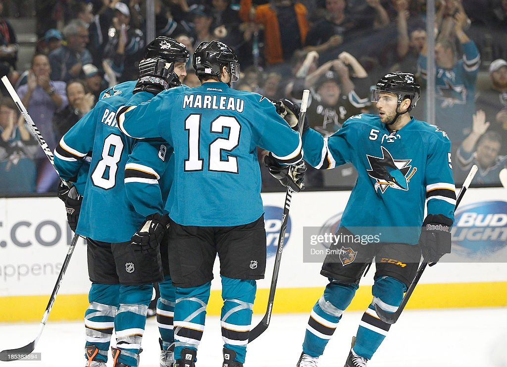 Patrick Marleau #12, <a gi-track='captionPersonalityLinkClicked' href=/galleries/search?phrase=Joe+Pavelski&family=editorial&specificpeople=687042 ng-click='$event.stopPropagation()'>Joe Pavelski</a> #8, <a gi-track='captionPersonalityLinkClicked' href=/galleries/search?phrase=Joe+Thornton&family=editorial&specificpeople=201829 ng-click='$event.stopPropagation()'>Joe Thornton</a> #19 and Jason Demers #5 of the San Jose Sharks celebrate a goal against the Calgary Flames during an NHL game on October 19, 2013 at SAP Center in San Jose, California.