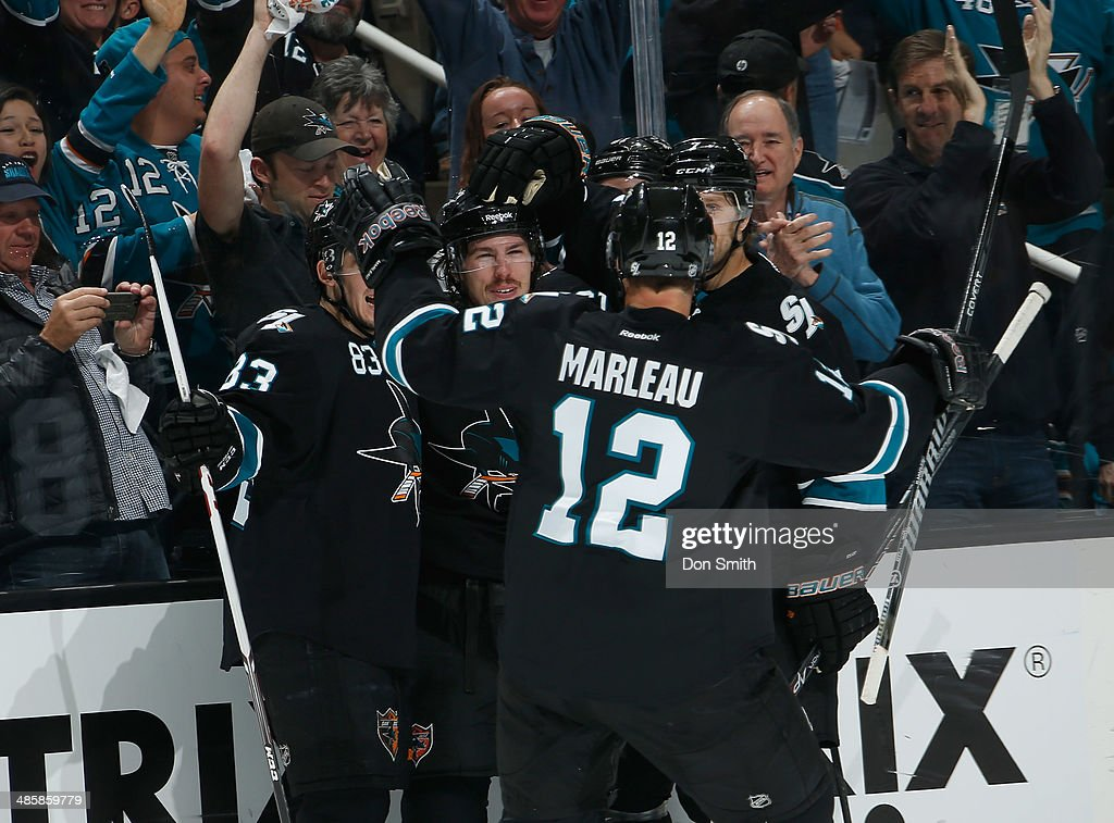 Patrick Marleau #12, Logan Couture #39 and Matt Nieto #83 of the San Jose Sharks celebrate a goal against the Los Angeles Kings in Game Two of the First Round of the 2014 Stanley Cup Playoffs at SAP Center on April 20, 2014 in San Jose, California.