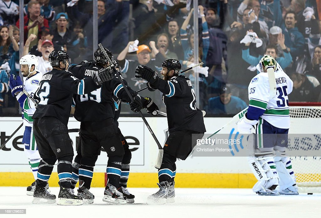 Patrick Marleau #12, Logan Couture #39, Joe Pavelski #8 and Joe Thornton #19 of the San Jose Sharks celebrate after Joe Pavelski #8 scored a first period power play goal against goaltender Cory Schneider #35 of the Vancouver Canucks in Game Three of the Western Conference Quarterfinals during the 2013 NHL Stanley Cup Playoffs at HP Pavilion on May 5, 2013 in San Jose, California.