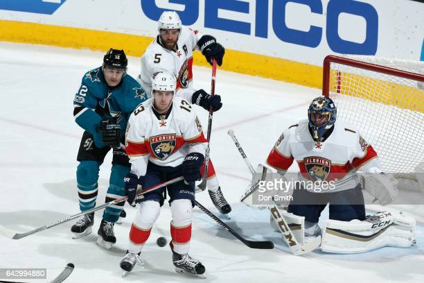 Patrick Marleau of the San Jose Sharks along with Aaron Ekblad Mark Pysyk and Roberto Luongo of the Florida Panthers watch the puck at SAP Center at...