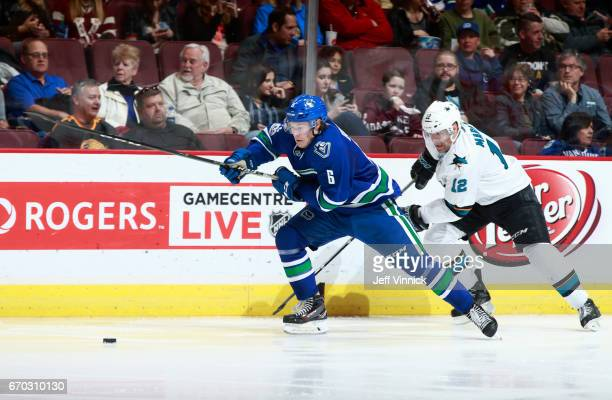 Patrick Marleau of the San Jose Sharks and Brock Boeser of the Vancouver Canucks skate after the puck during their NHL game at Rogers Arena April 2...