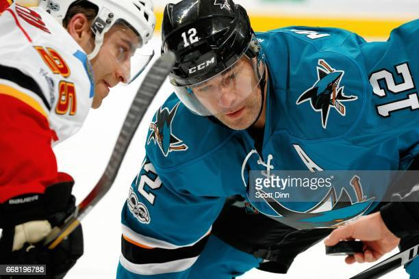 Patrick Marleau of the San Jose Sharks and Freddie Hamilton of the Calgary Flames get ready for a face off at SAP Center at San Jose on April 8 2017...