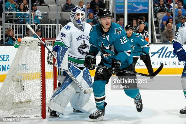 Patrick Marleau of the San Jose Sharks and Richard Bachman of the Vancouver Canucks look during a NHL game at SAP Center at San Jose on April 4 2017...