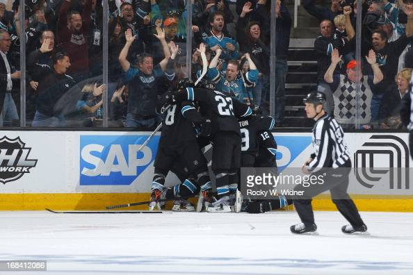 Patrick Marleau of the San Jose Sharks celebrate with teammates after making the winning goal against the Vancouver Canucks in Game Four of the...