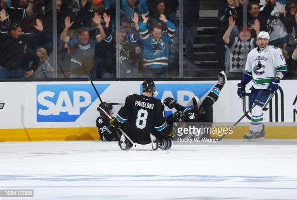 Patrick Marleau of the San Jose Sharks celebrate with teammates Logan Couture and Joe Pavelski after making the winning goal against the Vancouver...