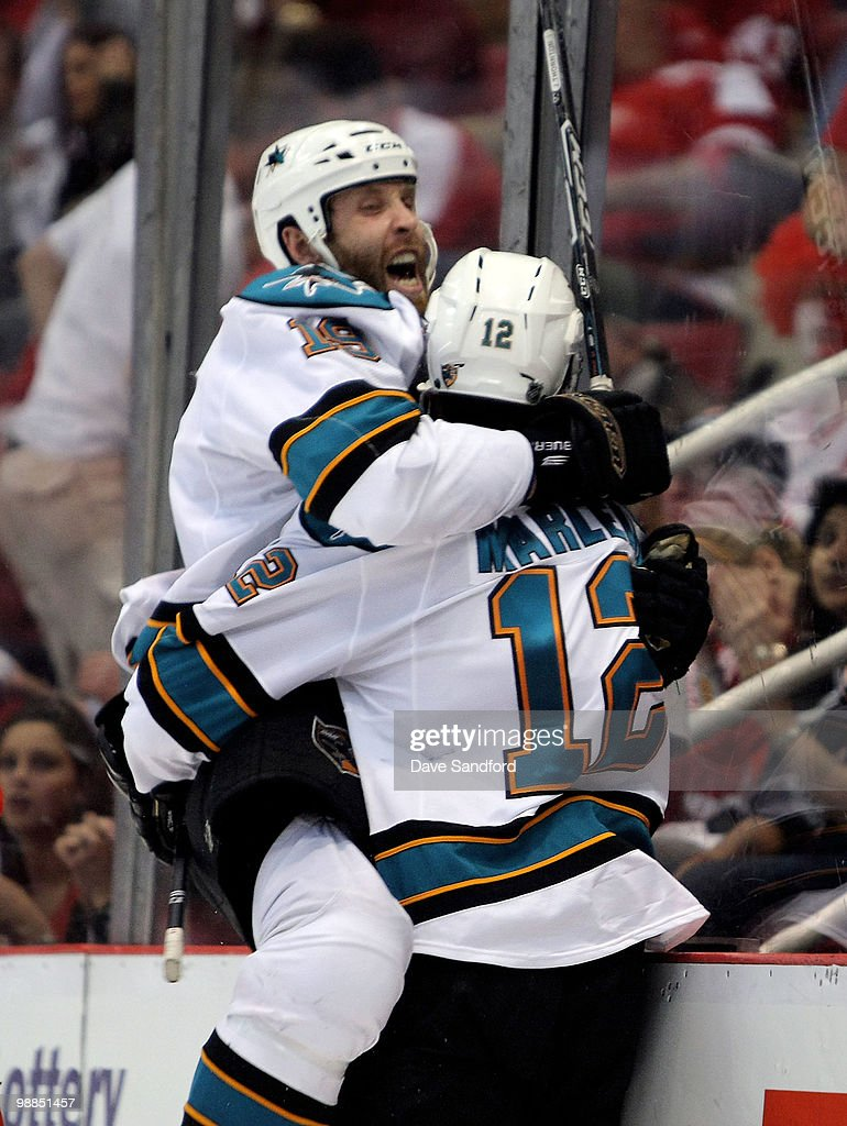 Patrick Marleau #12 of the San Jose Sharks celebrates his overtime game-winning goal with teammate Joe Thornton #19 who assisted on the goal against the Detroit Red Wings in Game Three of the Western Conference Semifinals during the 2010 Stanley Cup Playoffs at Joe Louis Arena on May 4, 2010 in Detroit, Michigan.