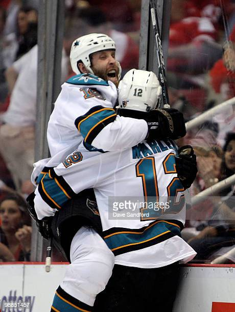 Patrick Marleau of the San Jose Sharks celebrates his overtime gamewinning goal with teammate Joe Thornton who assisted on the goal against the...
