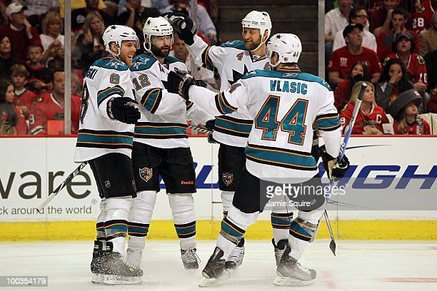 Patrick Marleau of the San Jose Sharks celebrates his second period goal with teammates Joe Pavelski Rob Blake and MarcEdouard Vlasic while taking on...