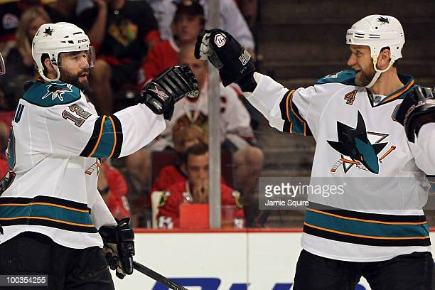 Patrick Marleau of the San Jose Sharks celebrates his second period goal with teammate Rob Blake while taking on the Chicago Blackhawks in Game Four...